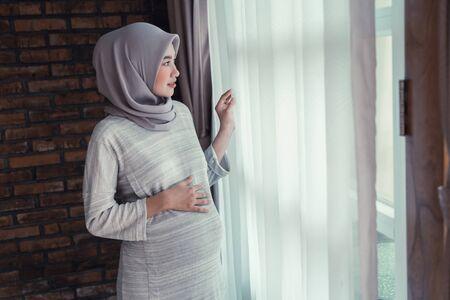 muslim pregnant woman asian