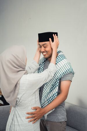 husband and wife muslim face to face each other Stock Photo