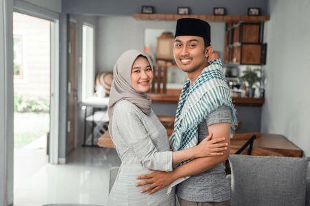 romantic muslim couple when wife pregnant