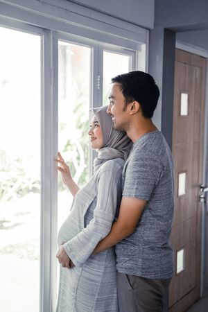 pregnant muslim wife leaning on romantic husband