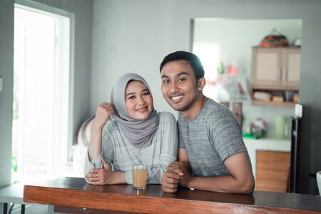 moslem couple relax sitting in the kitchen