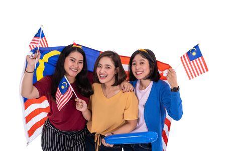 malay girls holding malaysia national flag