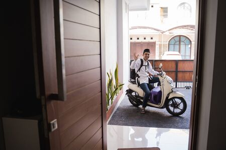 muslim male travelling for eid mubarak  by motorcycle Stock Photo