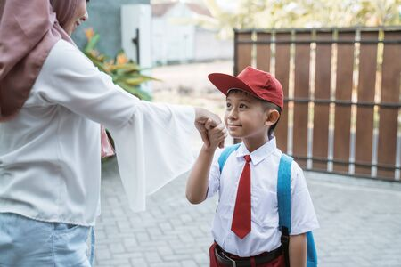 child shake hand and kissing hand before school Stok Fotoğraf - 127495903