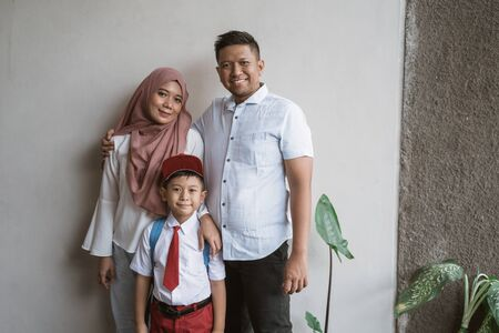 indonesia family with kid wearing school uniform