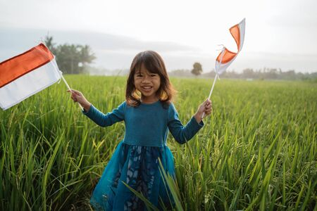 indonesian kid with national flag