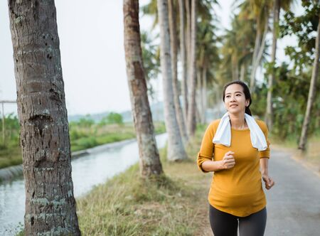 pregnant woman in her trimester workout outdoor Stock Photo