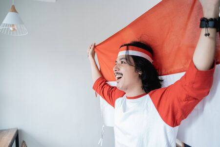 male holding indonesian flag. patriotic nationalism concept