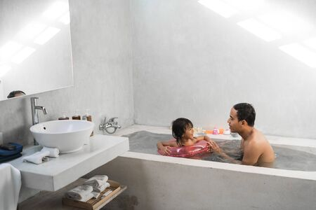 little girl with her father take a bath together