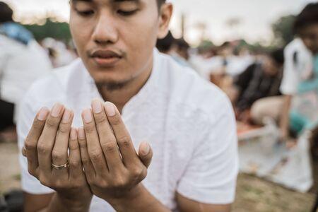 close up a man praying during Eid al-Fitr