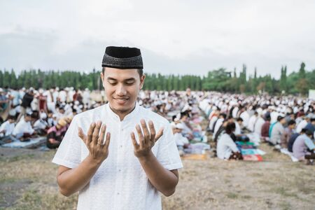 Asian youth wearing traditional prayer clothes