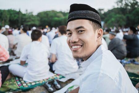 Asian man smile happily at Eid al-Fitr prayers