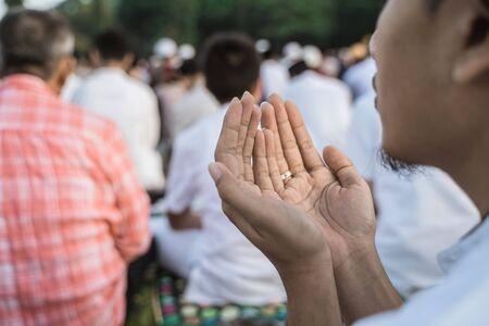 Asian man pray Eid prayer Stock Photo