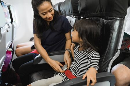 Mother efforts to secure her daughter on flight