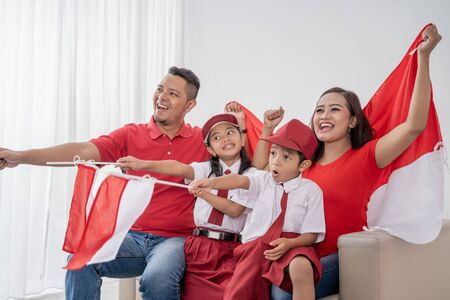 indonesian sport fans family watching tv