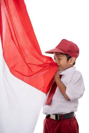 student kiss indonesia flag over white