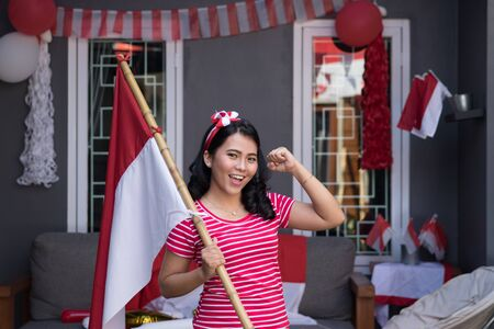 indonesian woman with indonesia flag during independence