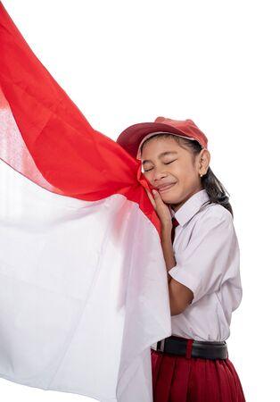 school girl kissing indonesia flag