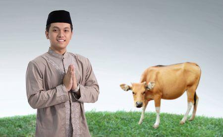 muslim man with cow for idul adha qurban celebration
