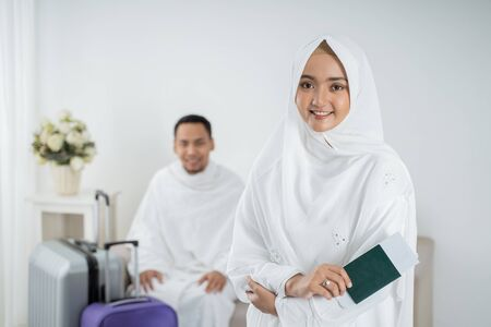 young woman wearing white traditional clothes for Ihram ready for Hajj