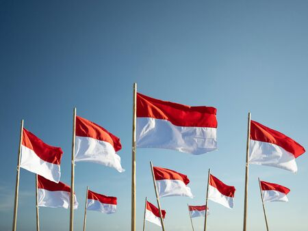indonesia flag under blue sky