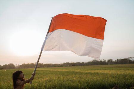 asian little girl flapping Indonesian flag Reklamní fotografie