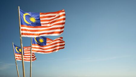 malaysia flags under blue sky independence day concept Banco de Imagens