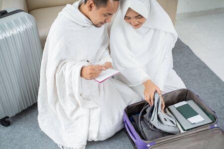 muslim family preparing luggage before hajj