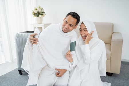 Muslim family in white traditional clothes selfie