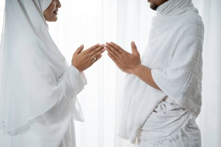 muslim asian couple shake hands