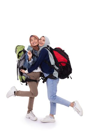 happy muslim backpacker smiling isolated over white background