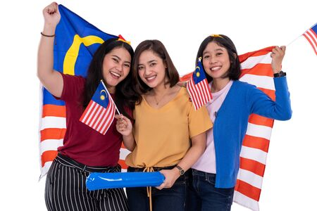 malay girl holding malaysia national flag Stock Photo