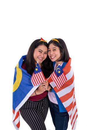 malay woman holding malaysian national flag Stock Photo
