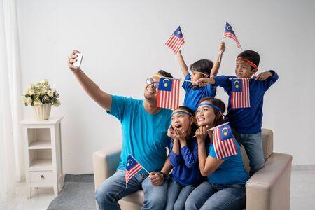 malaysia family with kids take selfie