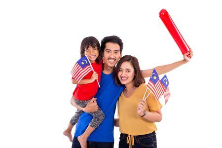 malay woman holding malaysia national flag with husband