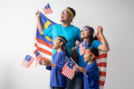 malaysia family with attributes and flag celebrating 版權商用圖片