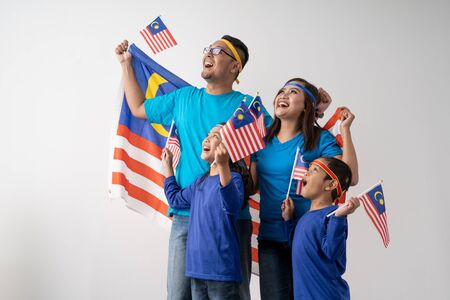 malaysia family with attributes and flag celebrating
