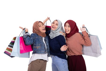 Asian young veiled women carrying some paper bag after shopping