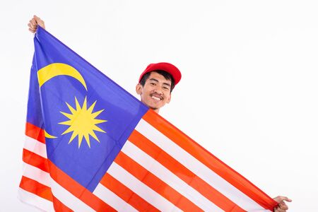 asian young male holding malaysia flag Reklamní fotografie