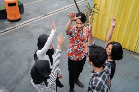 group of friends raised hands Reklamní fotografie