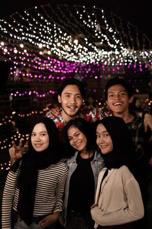 happy friends enjoy the night