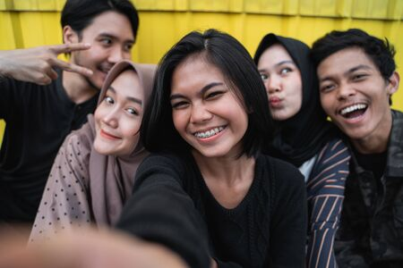 young people selfie together with friends