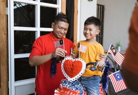 Malaysian family on malaysia independence day