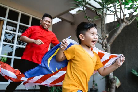 Malaysian kid with flag running