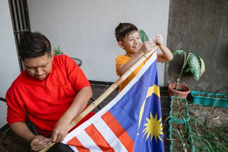 Family celebrating malaysia national independence day Stockfoto