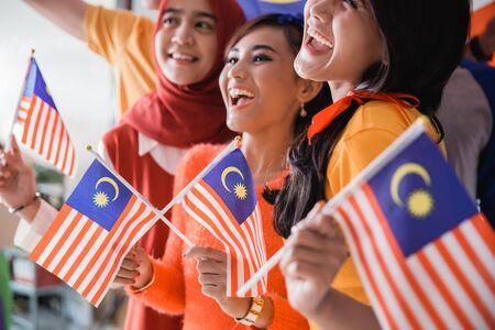 Malaysian family celebrating malaysia independence day Reklamní fotografie