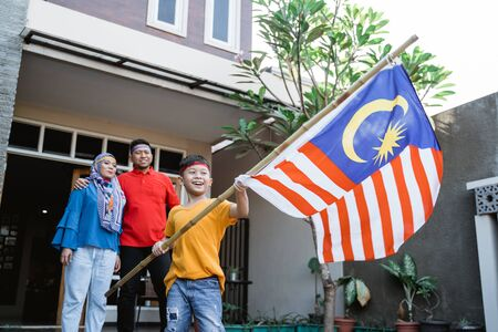 Malaysian family celebrating malaysia independence day Stockfoto