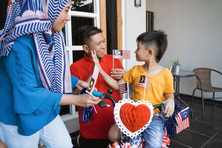 Malaysian family celebrating malaysia independence day Stok Fotoğraf