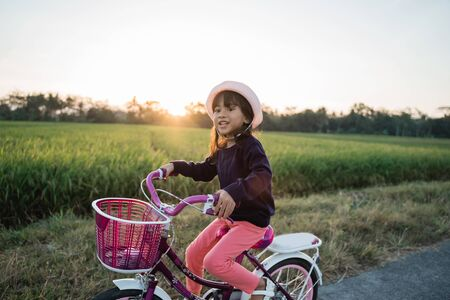 Toddler enjoy riding her bicycle outdoor