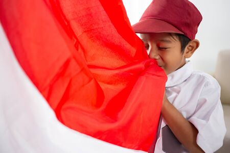 Student kiss indonesia flag over white